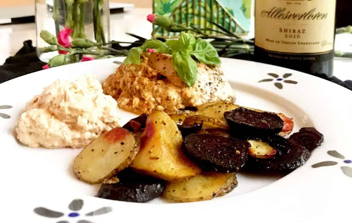 Feta stuffed chicken with roasted beets and potatoes on a plate
