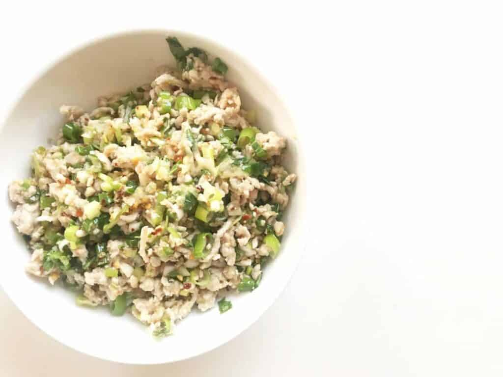 Larb Gai - Bring Thailand home to your own kitchen in just 10 minutes with this quick and delicious Larb Gai, filled with sumptuous Thai flavors such as lime, cilantro, chili and fish sauce. Sweet, savory, spicy and easily served as the best version of TV-dinner there is.