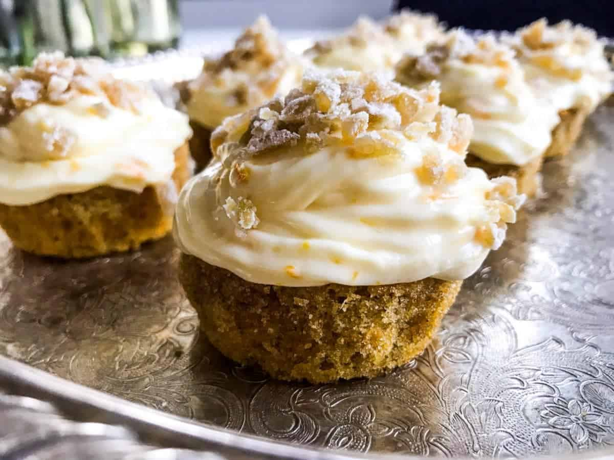 Orange ginger carrot cupcakes on a silver tray