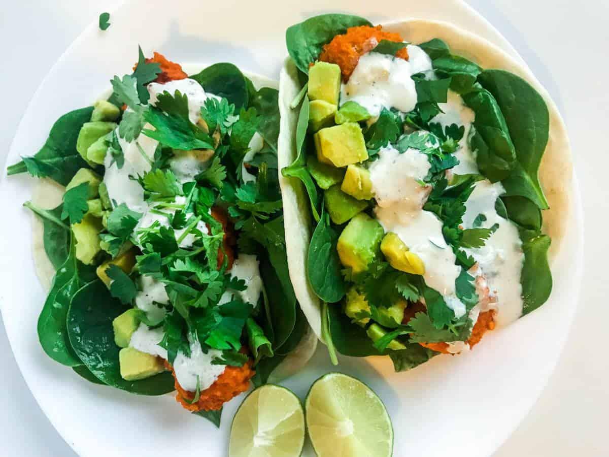 Buffalo cauliflower tacos on a white plate