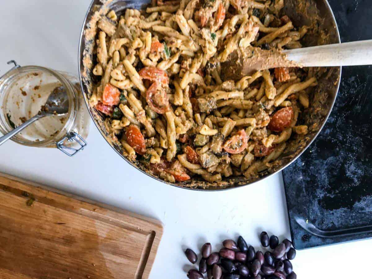 Red pesto pasta with roasted veggies in the making