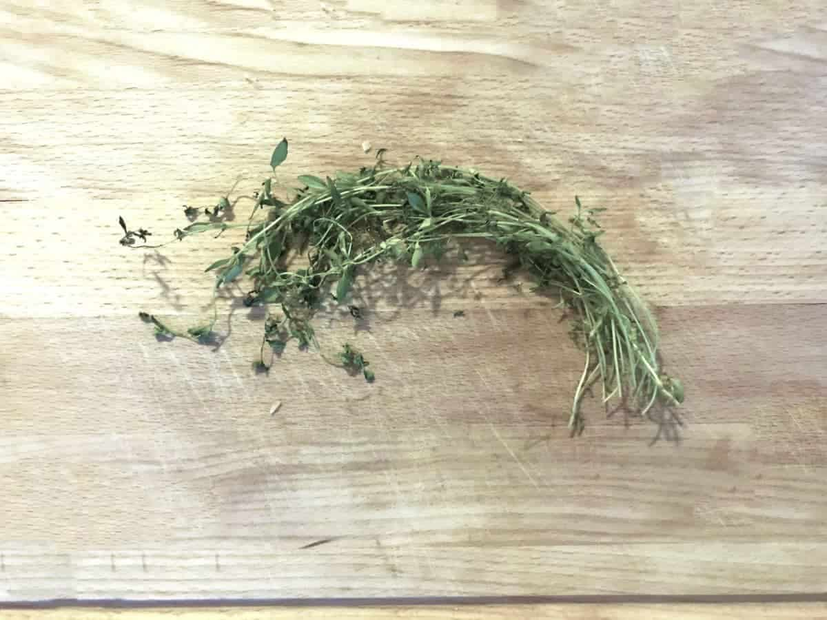 Fresh thyme on wooden chopping board