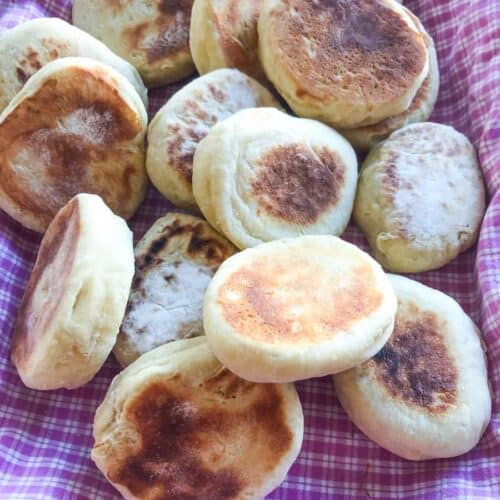 Overnight english muffins on a pink and white checkered cloth