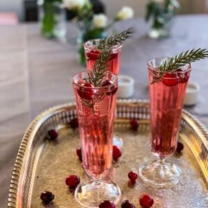 3 glasses of cranberry champagne cocktails