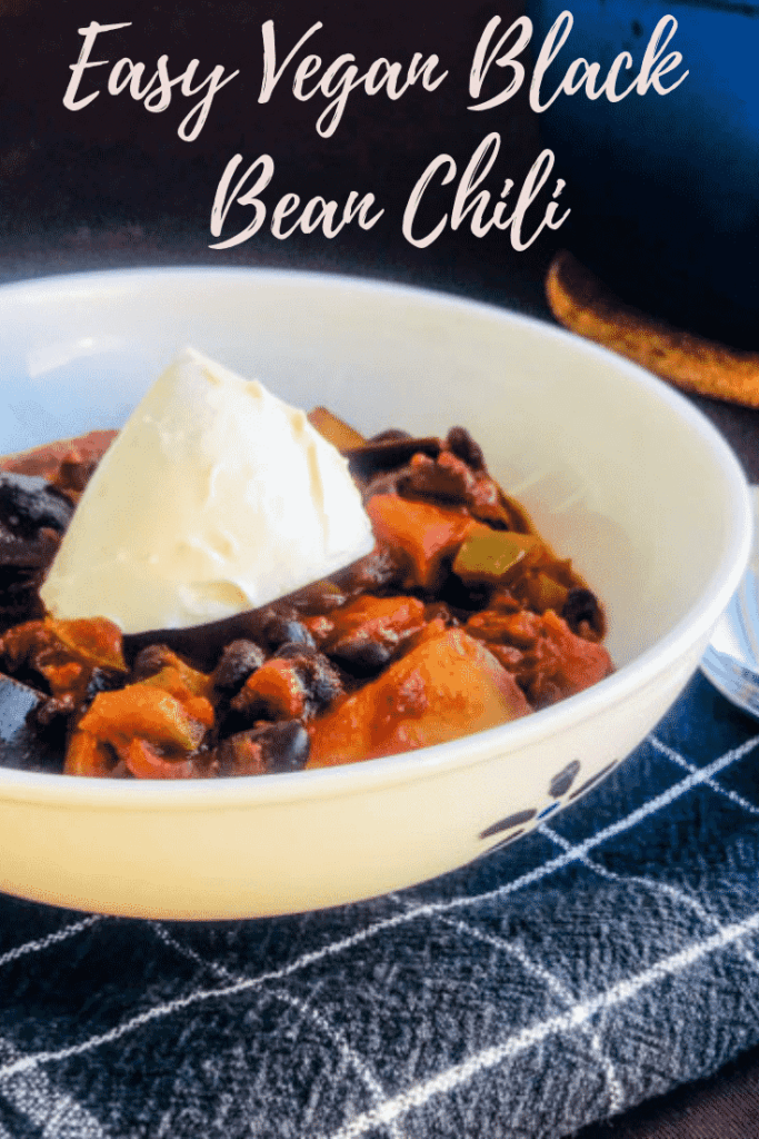 Vegan black bean chili in a white bowl