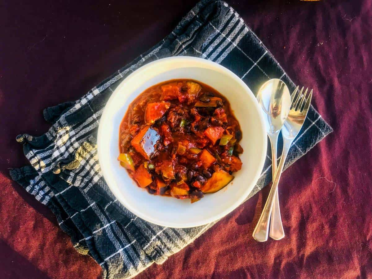 Vegan black bean chili in a white bowl