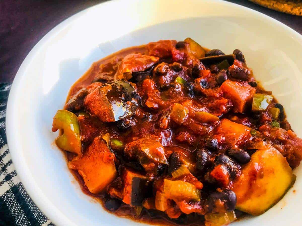 Vegan black chili in a white bowl