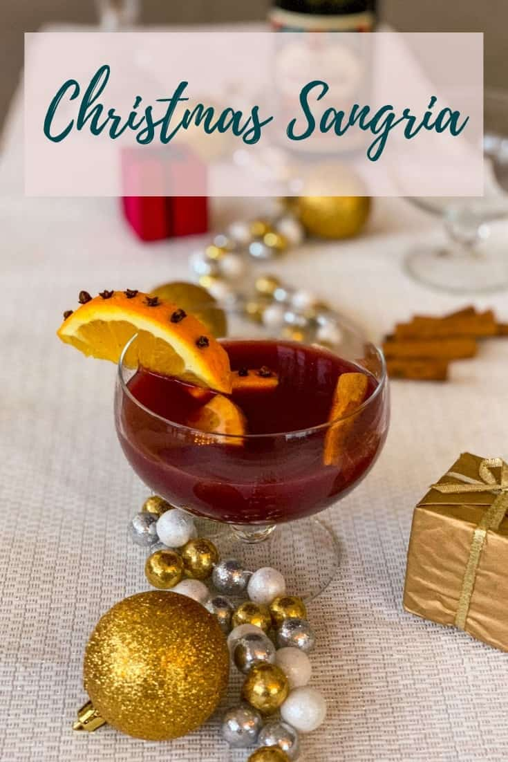 Christmas Sangria is the best simple version of sangria, seasoned for the Holidays with whole cinnamon and cloves and topped with just a hint of sparkle. #alwaysusebutter #christmas #holidays #sangria #cinnamon #cloves #redwine #coktail