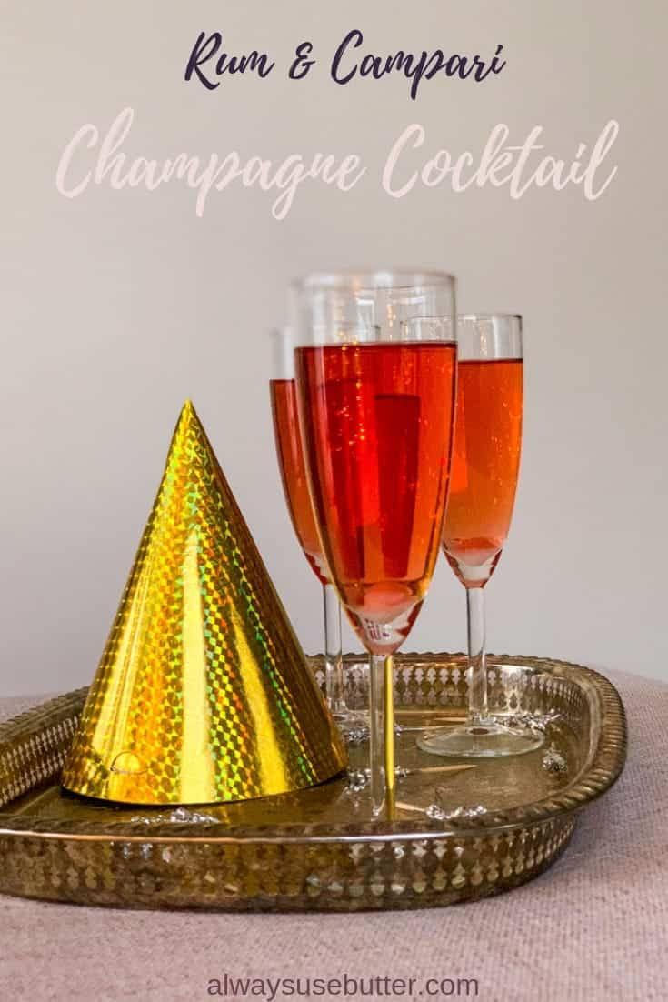 A twist on the Classic Champagne Cocktail, this Rum & Campari Champagne Cocktail is a bit more mellow with rum & Campari in place of cognac & Angostura bitter. But don't worry, the Champagne is still there! #alwaysusebutter #champagnecocktail #newyearseve #rum #campari