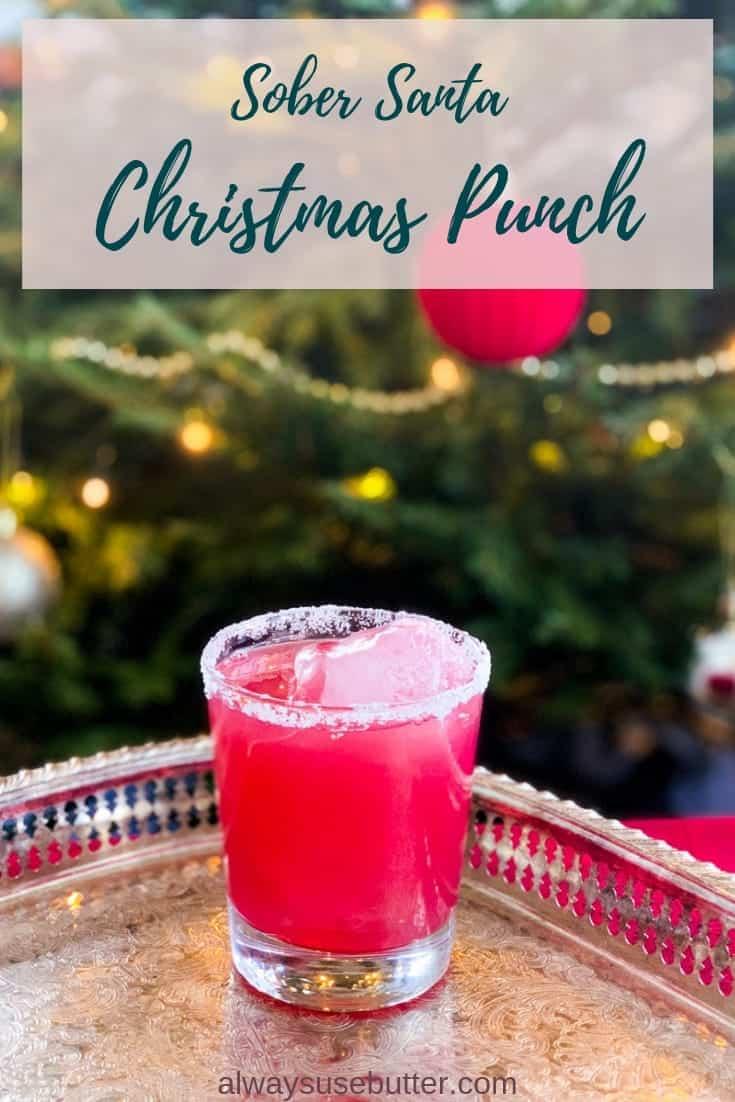 Sober Santa Christmas Punch is the perfect grown-up yet non-alcoholic cocktail - just slightly sweet, a hint of bitter & topped with a salted rim. #alwaysusebutter #mocktail #cocktail #non-alcoholic #christmaspunch