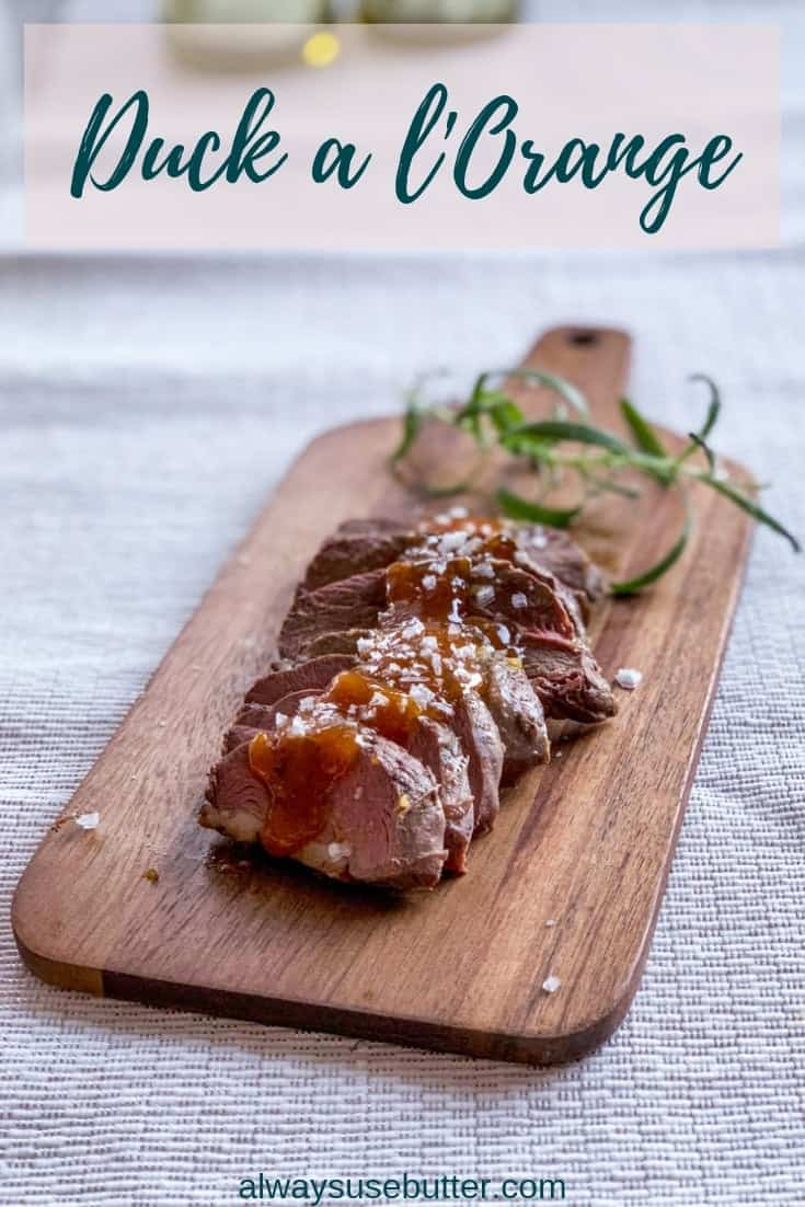Duck a l'Orange - Duck with Orange Sauce - with duck glazed in a deliciously sweet and sour honey, orange & rosemary sauce & a guide to cooking duck. Perfect to prep ahead and serve at New Year's! #alwaysusebutter #duck #orangesauce #newyearseve #dinnerparty