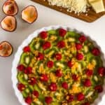bananas, kiwis, raspberries and passion fruit in a pie dish for passion fruit gino fruit bake with passion fruit and white chocolate