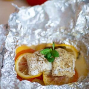 foil packet cod with tomatoes, lemon and potatoes