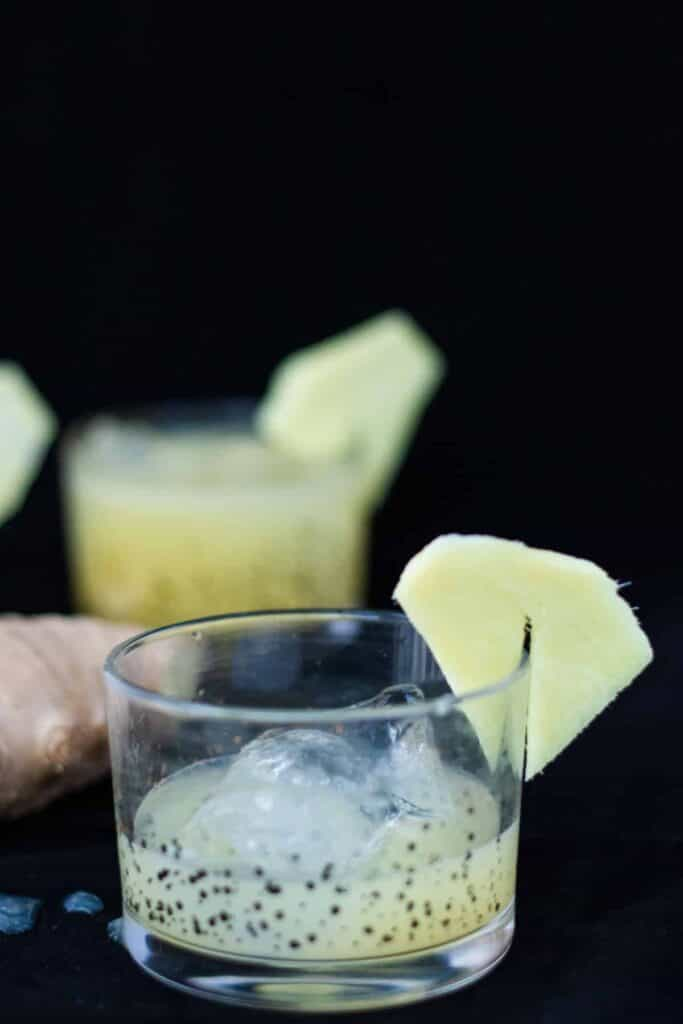 lemon ginger mocktail in a glass against a black background