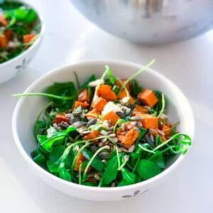 roasted sweet potato & feta cheese salad with tahini sauce in a bowl