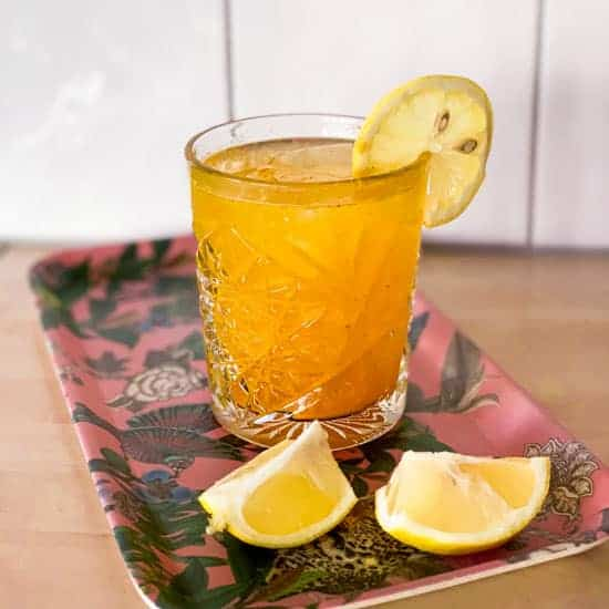 the resolution keeper non-alcoholic detox cocktail in a glass with a lemon slice