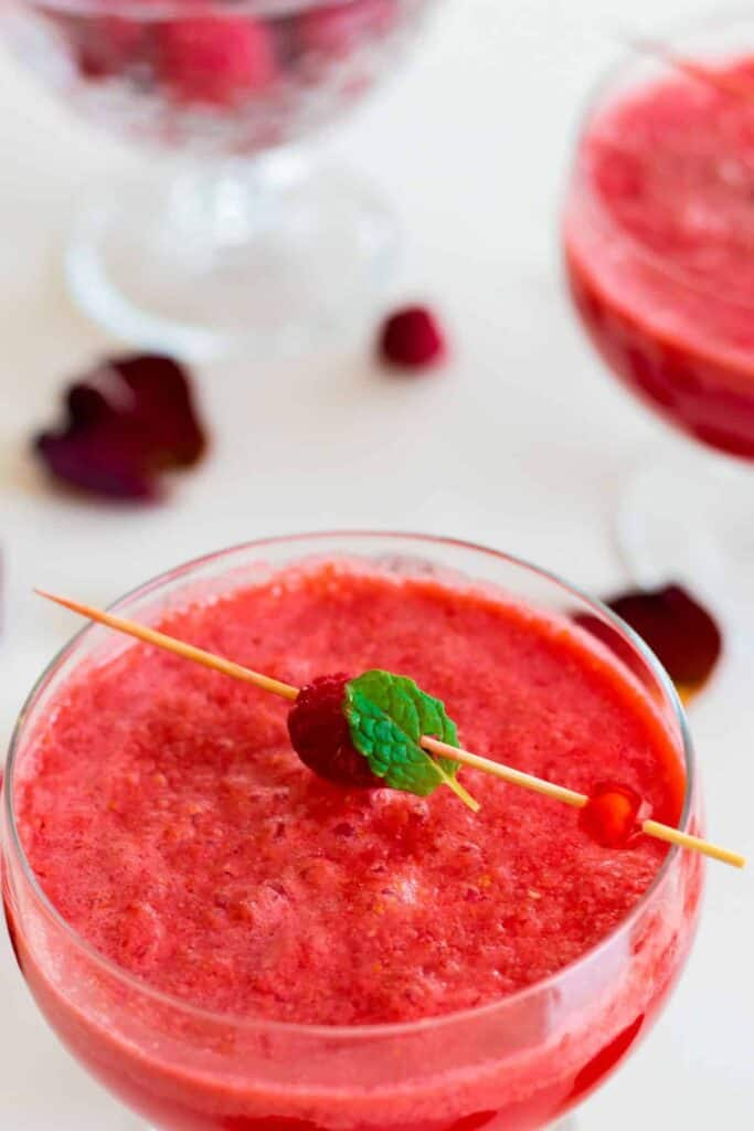 a glass of sparkling raspberry grapefruit mocktail
