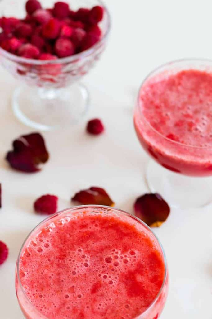 two glasses of sparkling raspberry grapefruit mocktail without decorations