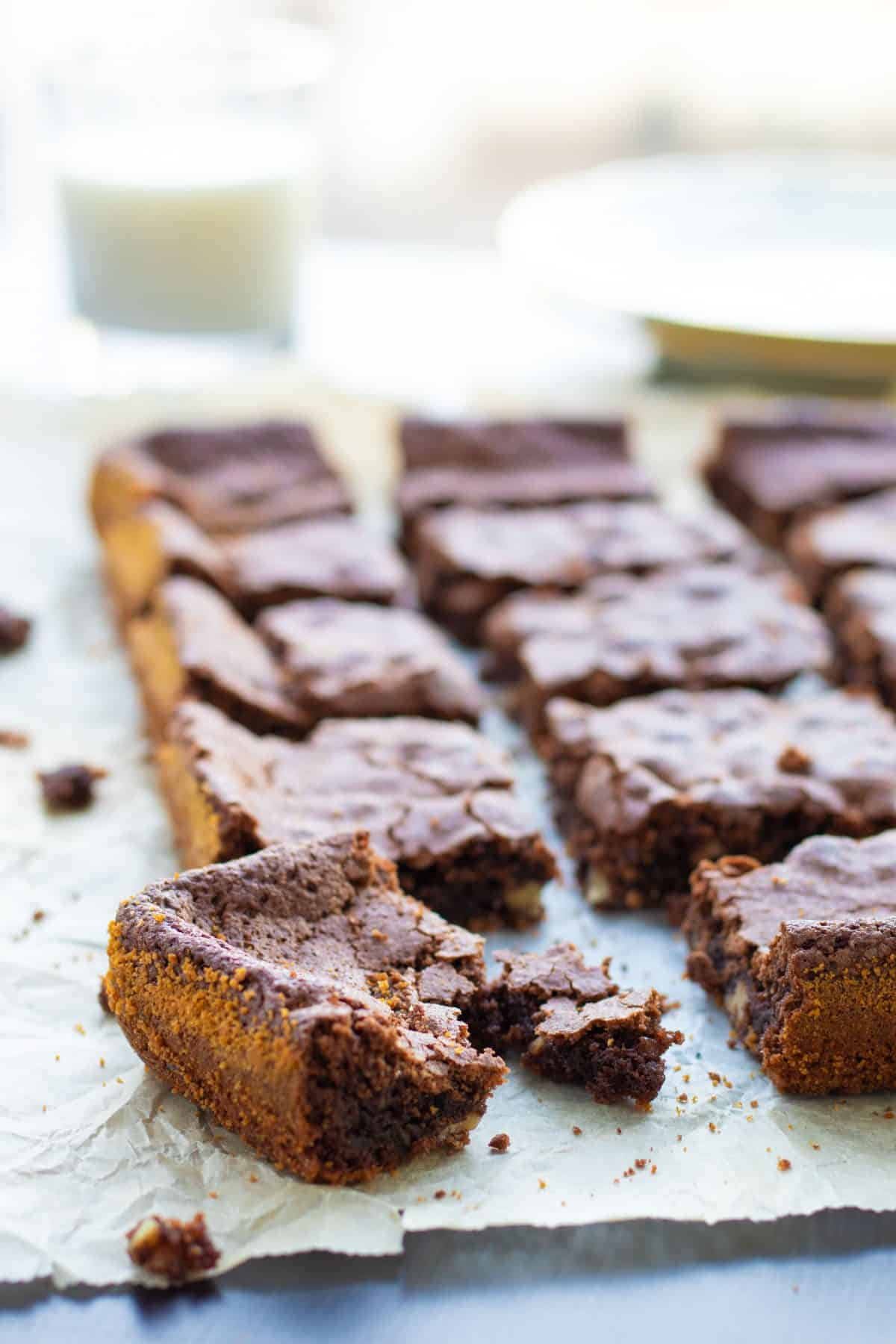 a stack of four brownies with cocoa powder