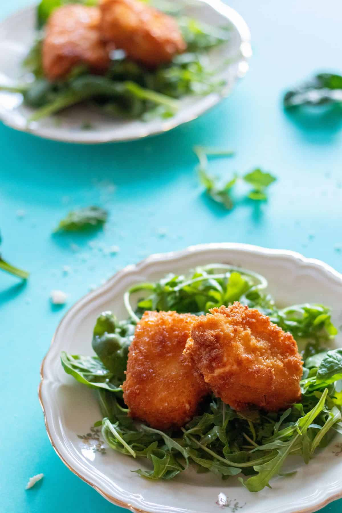 panko breaded feta cheese on a bed of greens