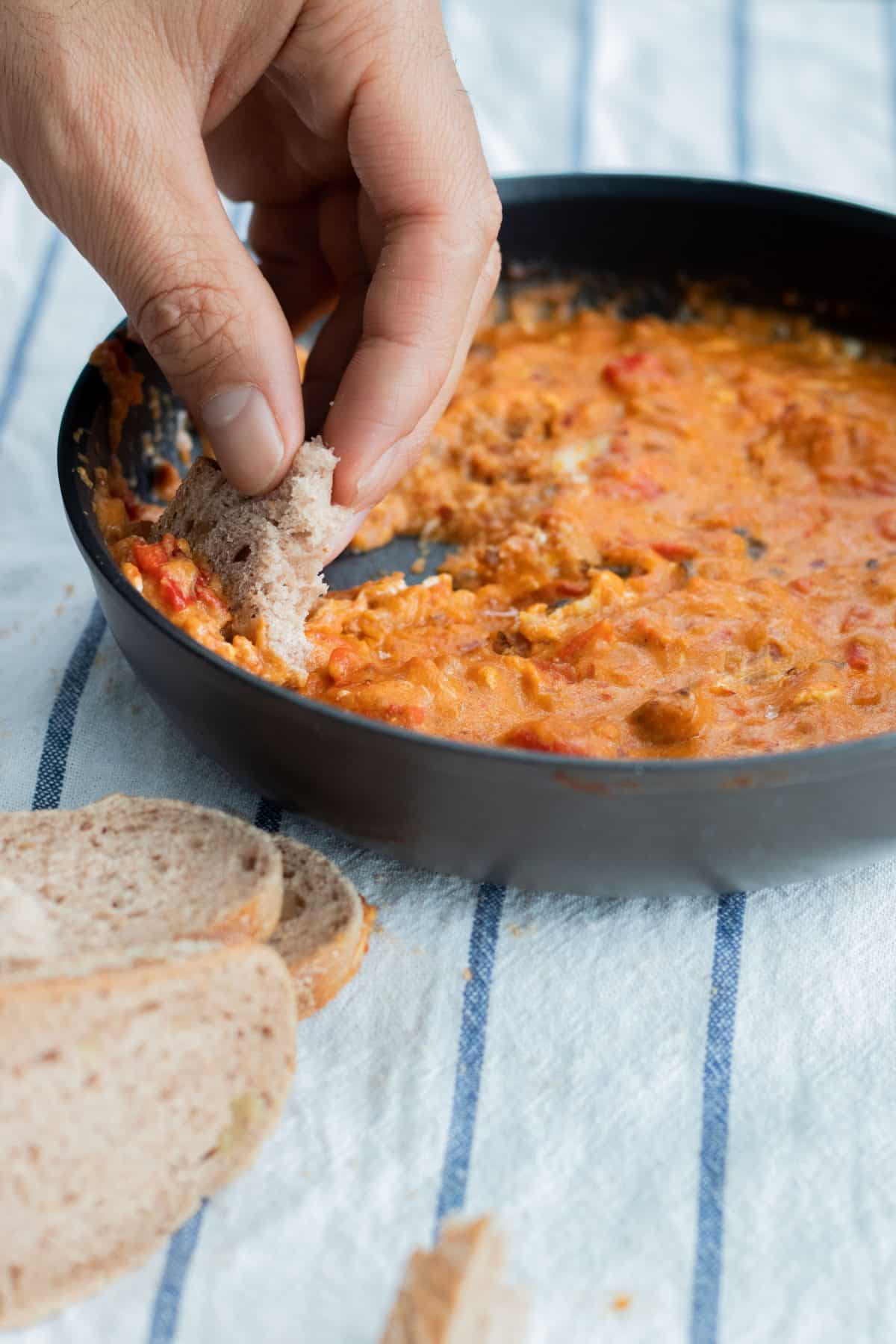 eating shakhuka with bread straight from the pan