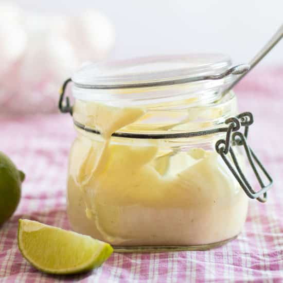 side view of a jar full of lime aioli
