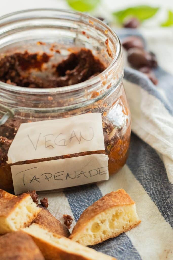 sideview of a jar with tapenade with tapenade with vegan tapenade written on the jar