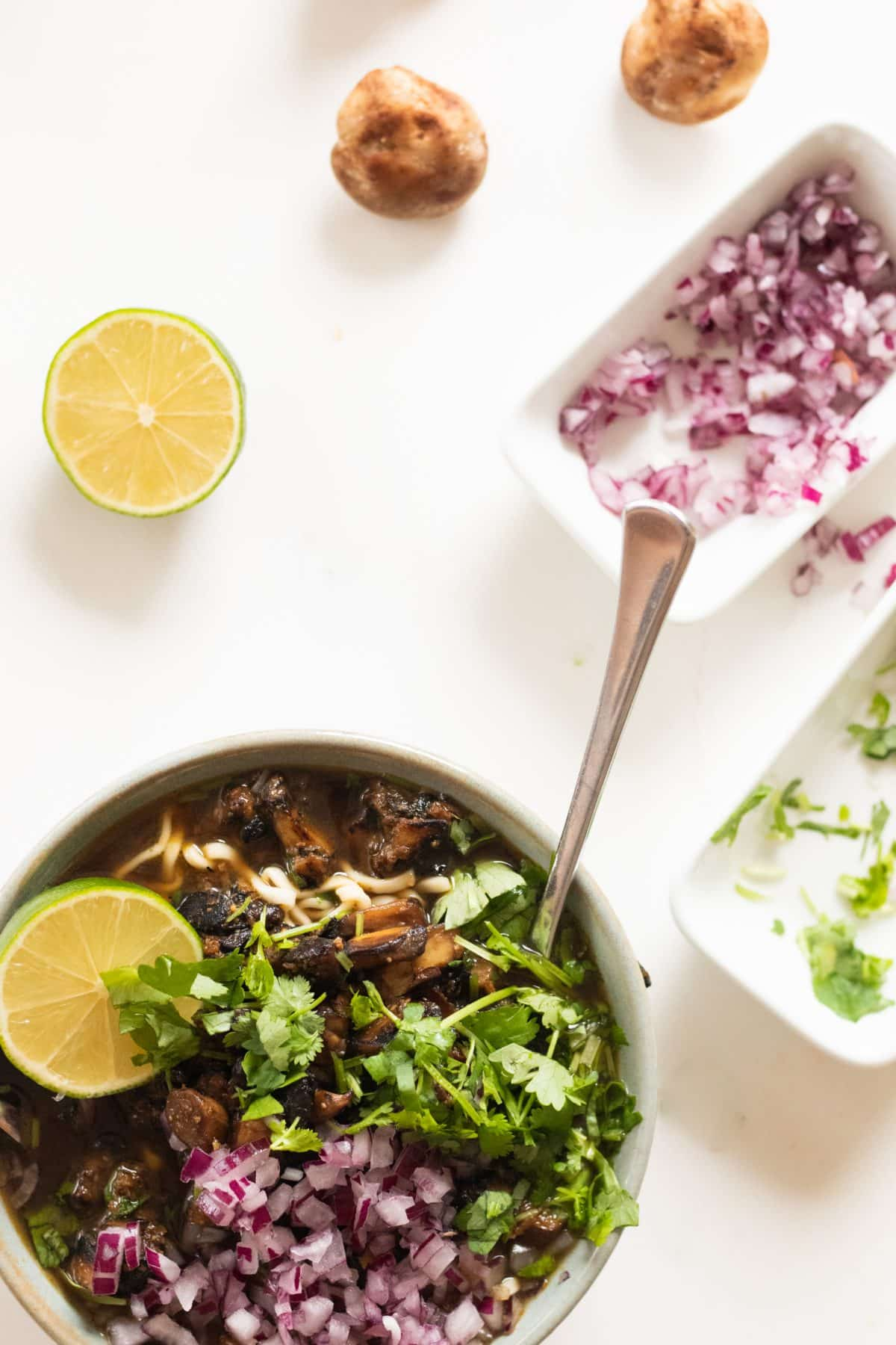 top view of a bowl of vegetarian ramen with mushrooms