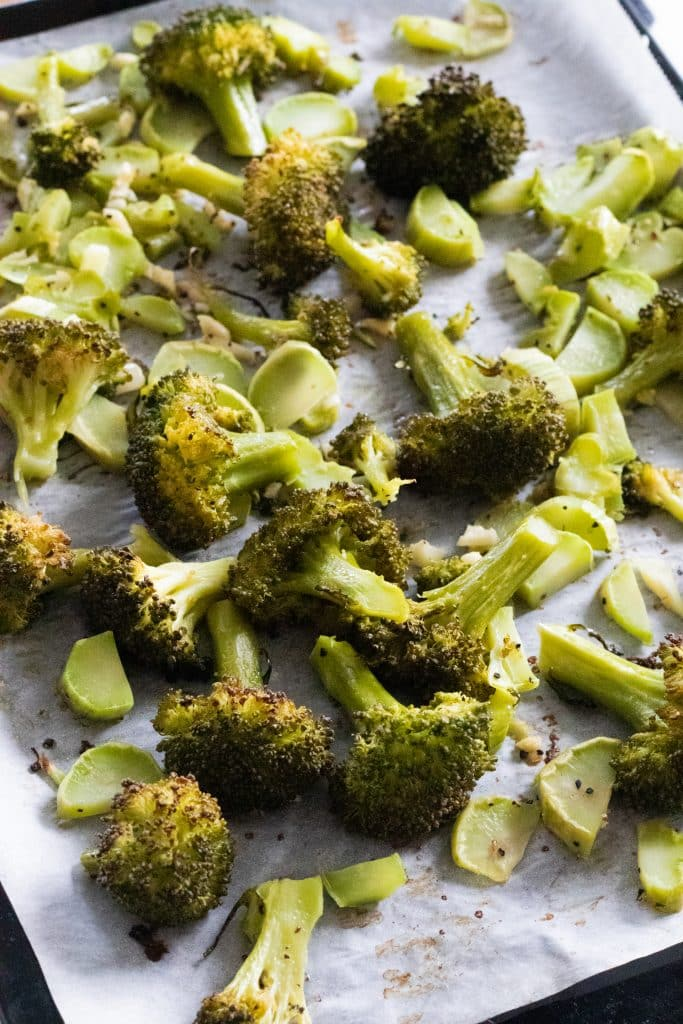 top view of an oven tray with garlic roasted broccoli