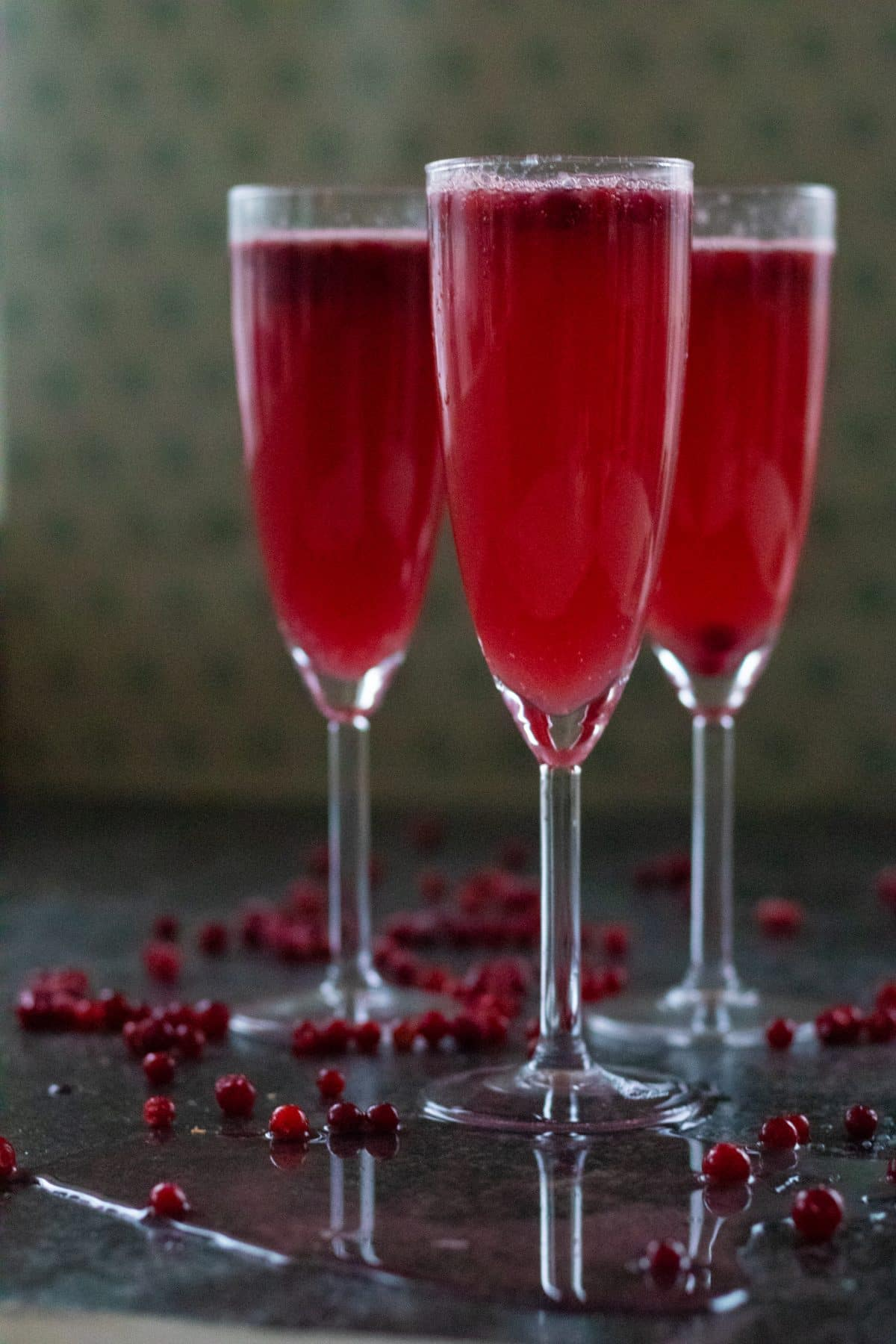 three glasses of cranberry ginger ale punch