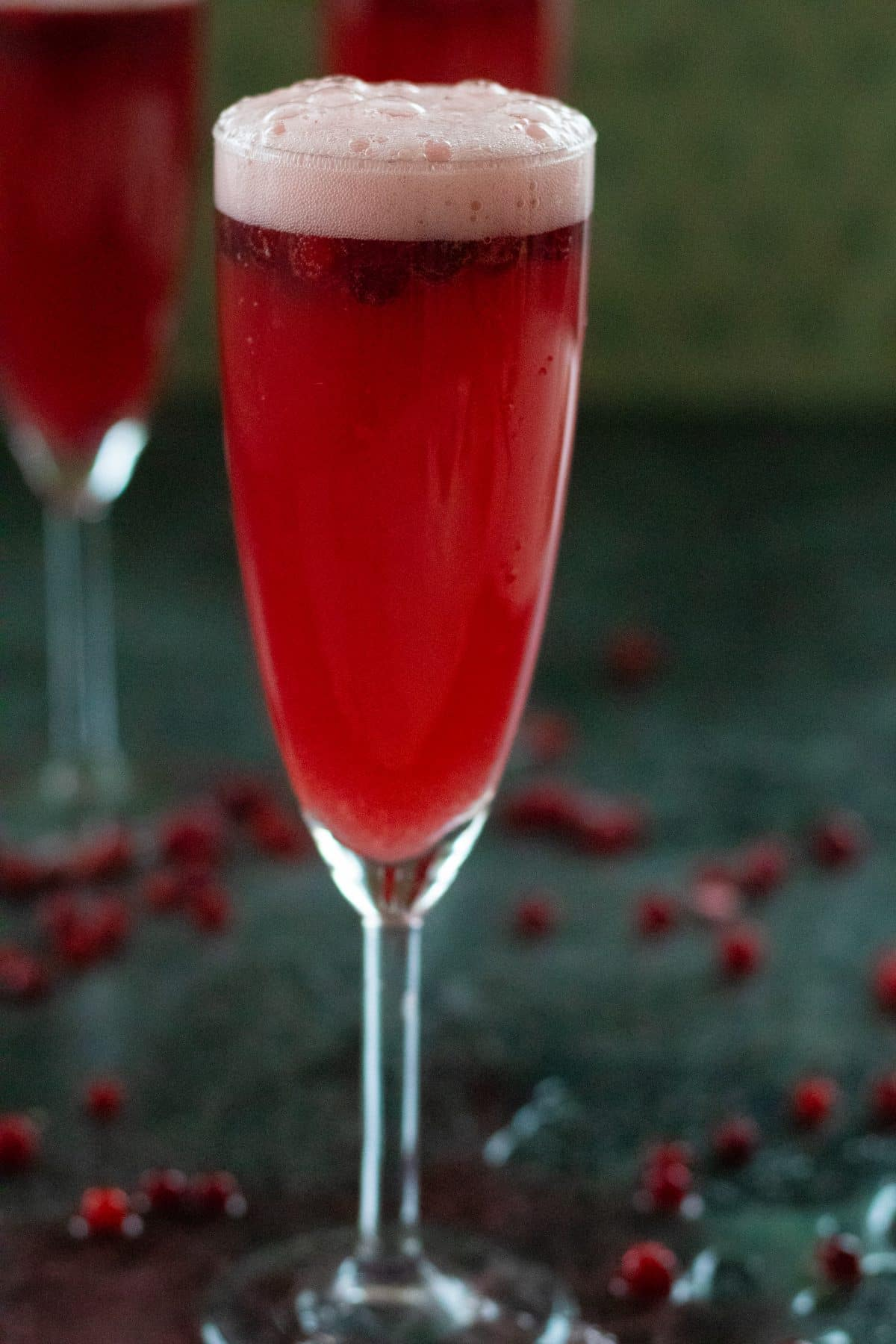 a glass of cranberry ginger ale punch