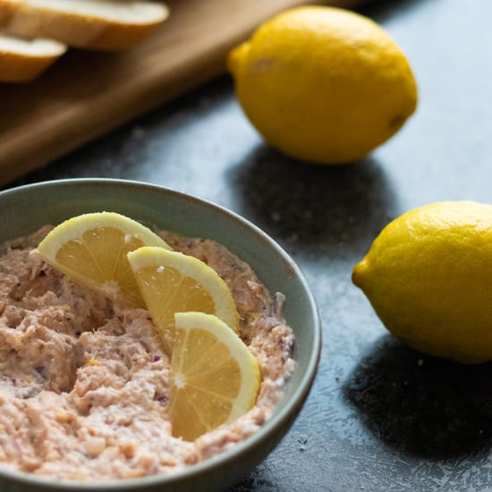 salmon pâté with hot smoked salmon in a bowl topped with lemon slices