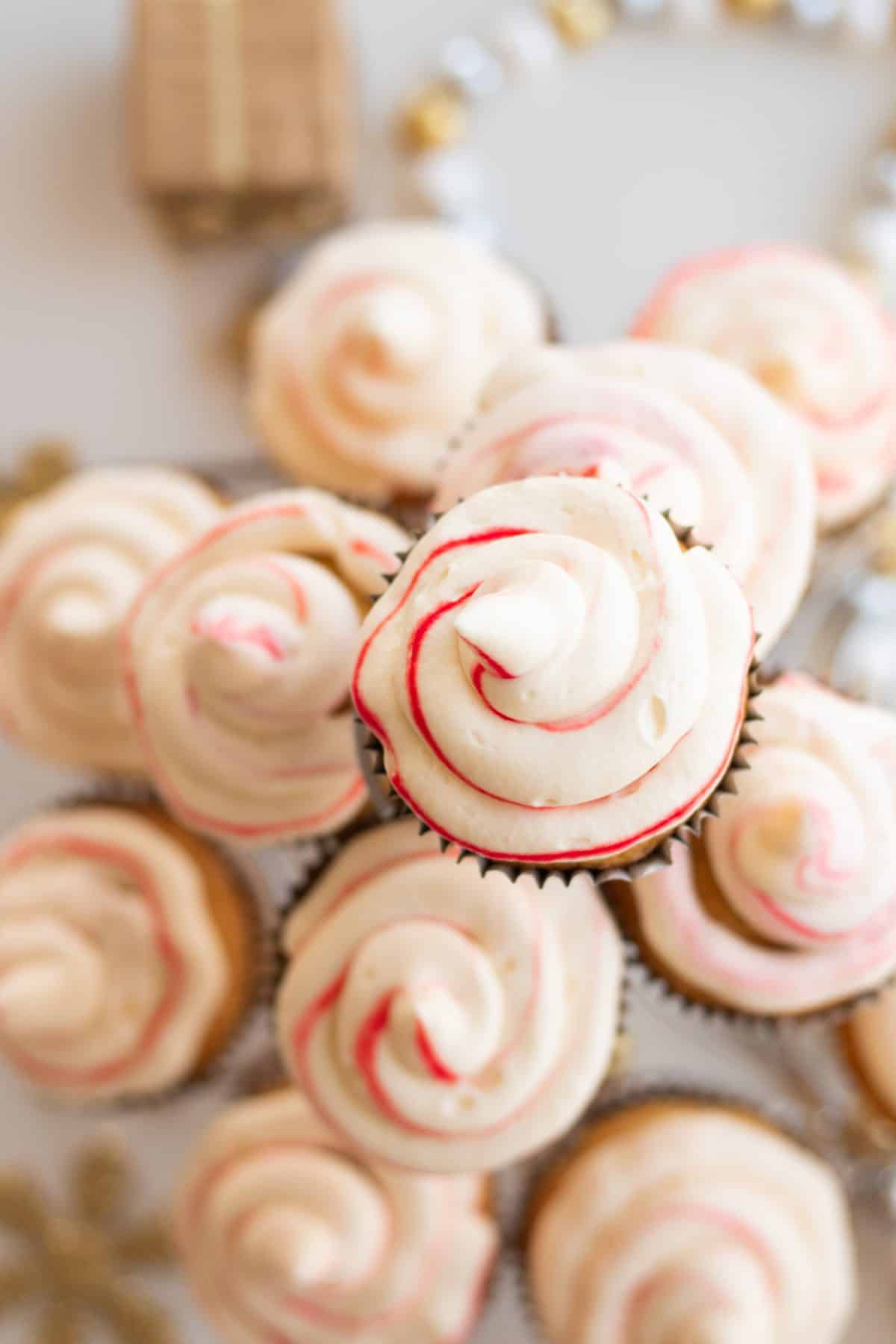 top down view of candy cane cupcakes on a cupcake stand