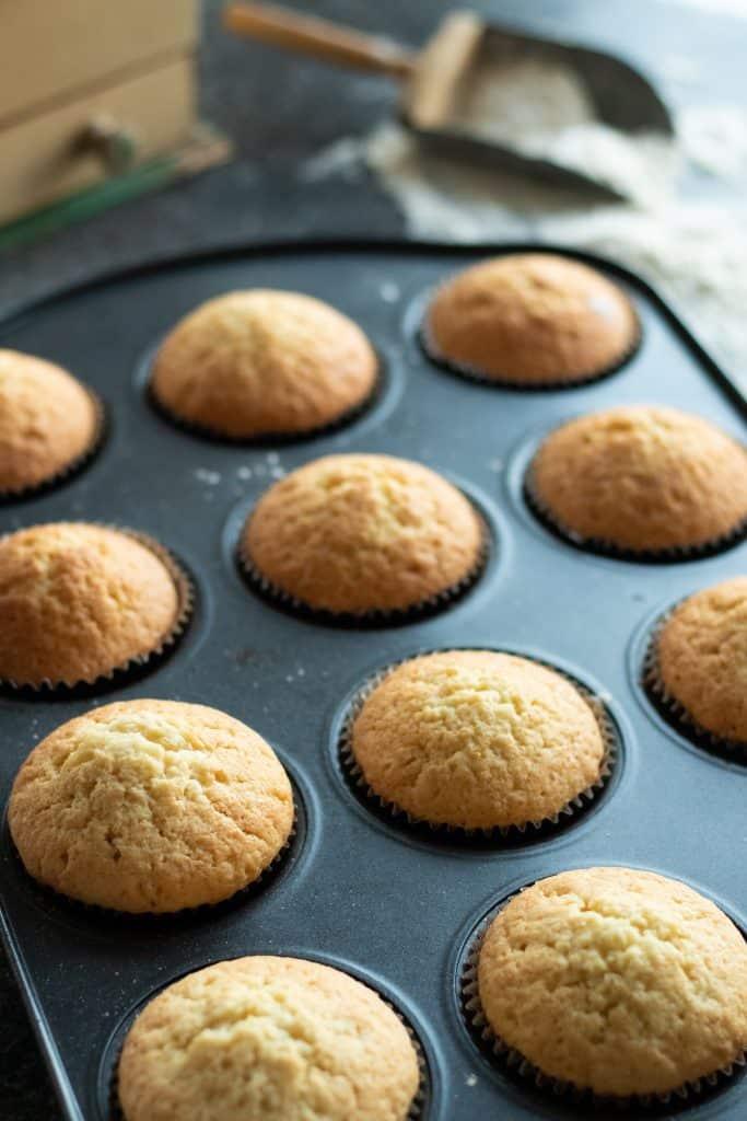 a tray of vanilla muffins