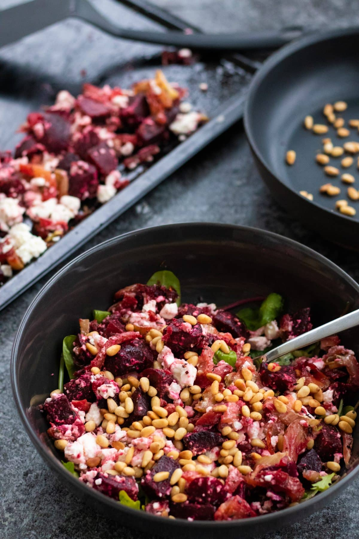 roast beetroot salad with feta cheese topped with pine nuts in a salad bowl