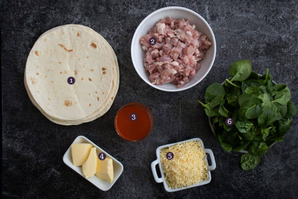 top down image showing ingredients needed to make buffalo chicken quesadillas