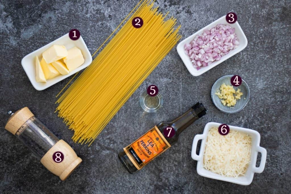 top down image showing ingredients needed to make garlic butter pasta