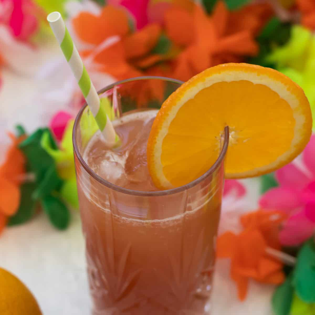 sex on the beach mocktail decorated with an orange slice and a straw