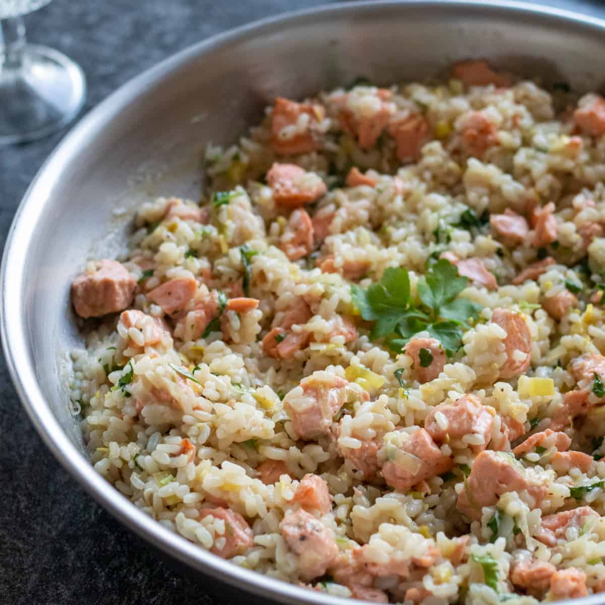 side view of salmon risotto with lemon