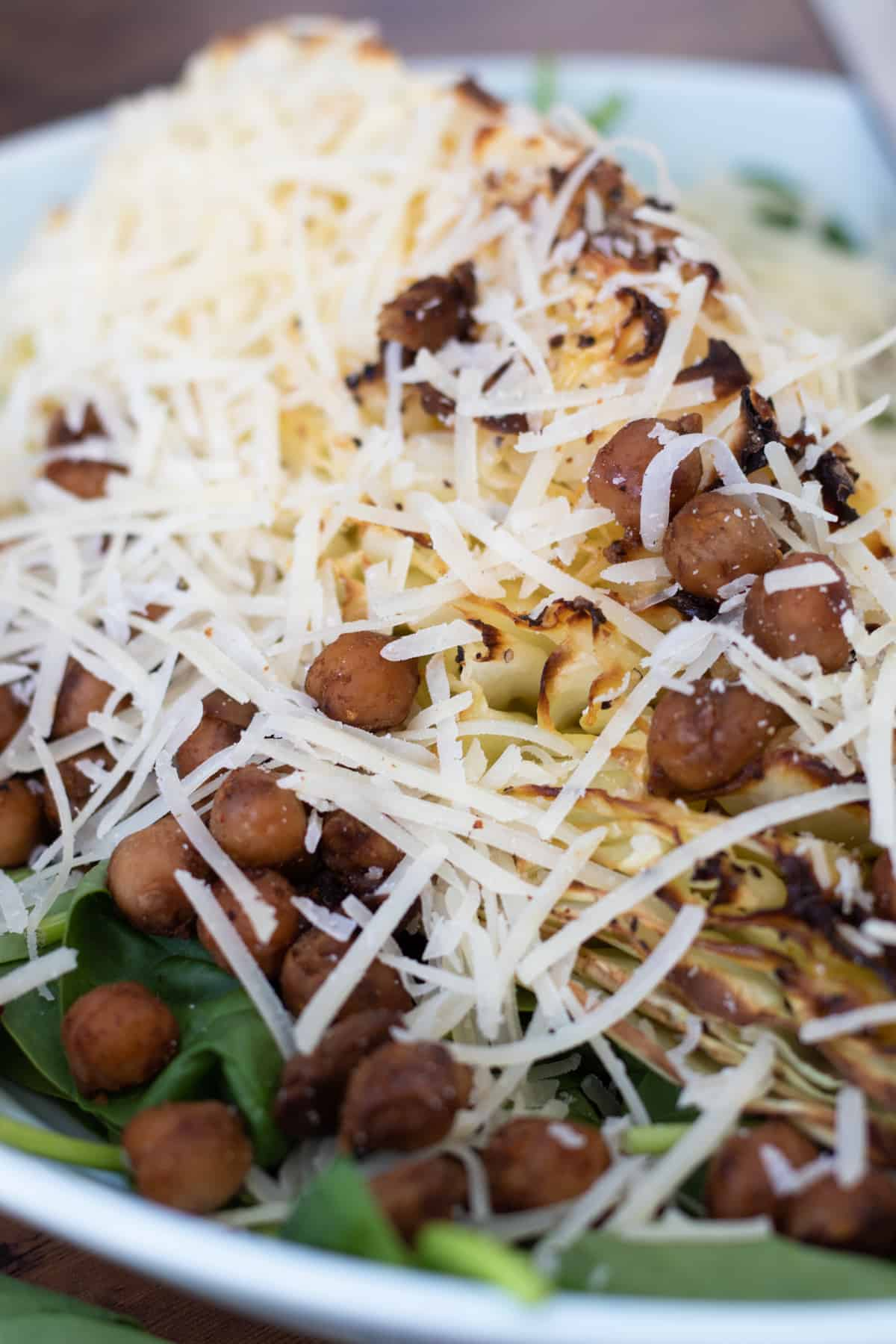 close up of a sweetheart cabbage salad with chickpeas and parmesan cheese