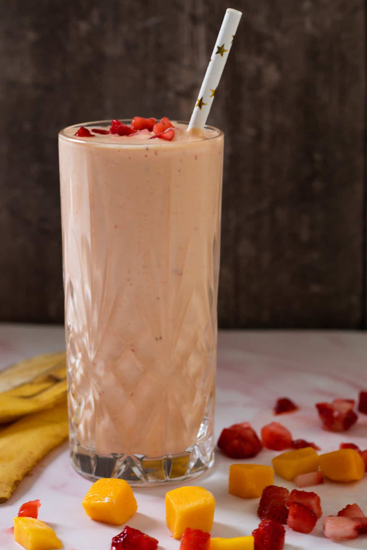 side view of a strawberry mango smoothie