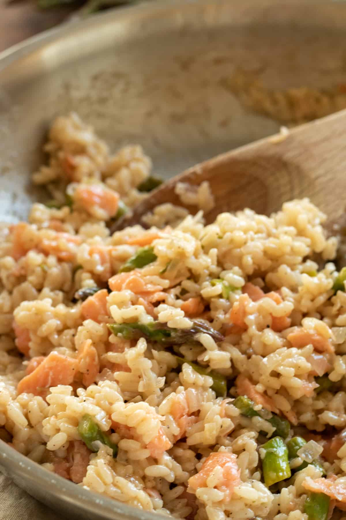 close-up of smoked salmon risotto in a pan