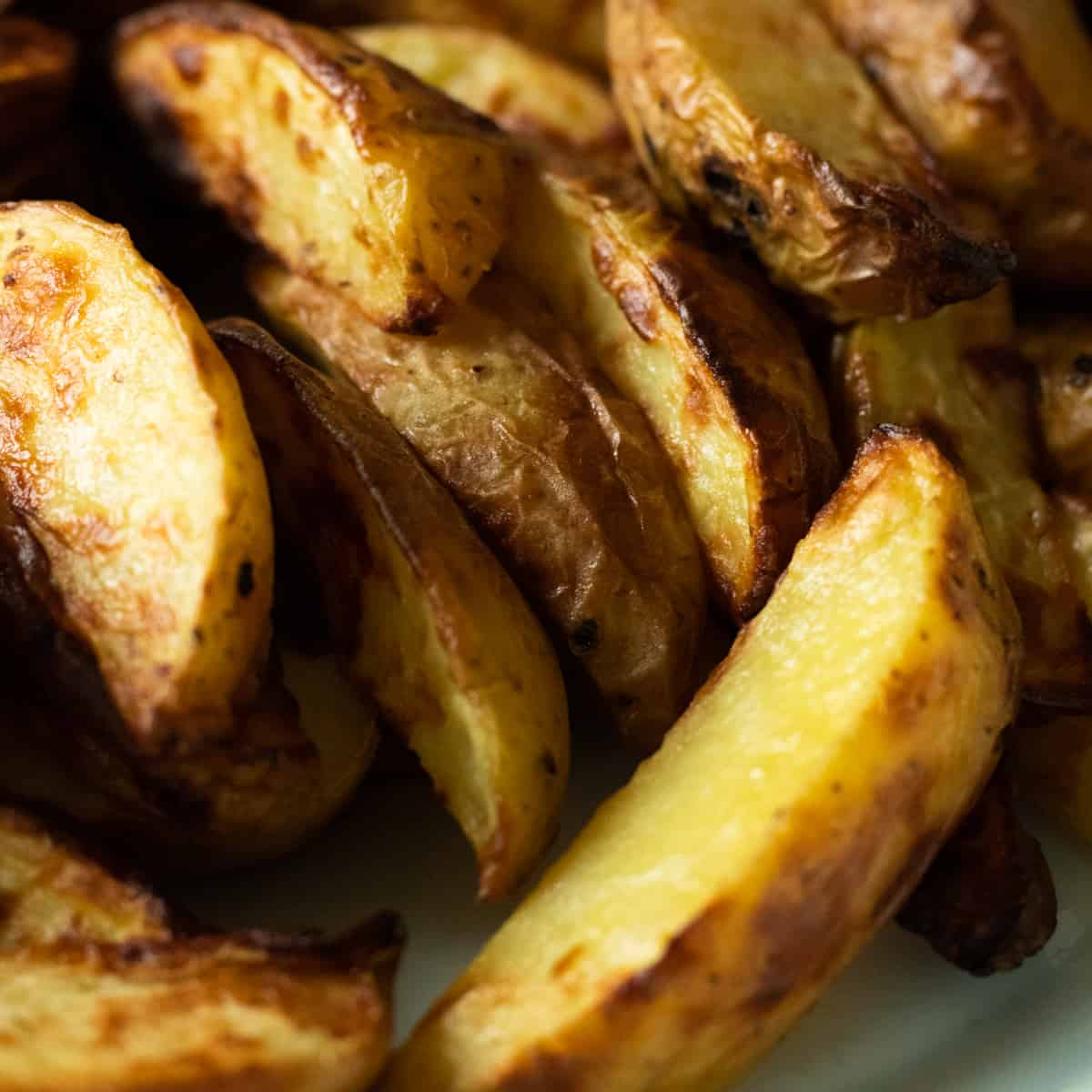 close up of air fryer potato wedges