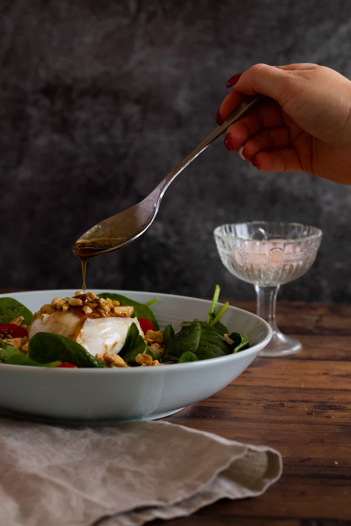 vinaigrette being drizzled over a salad