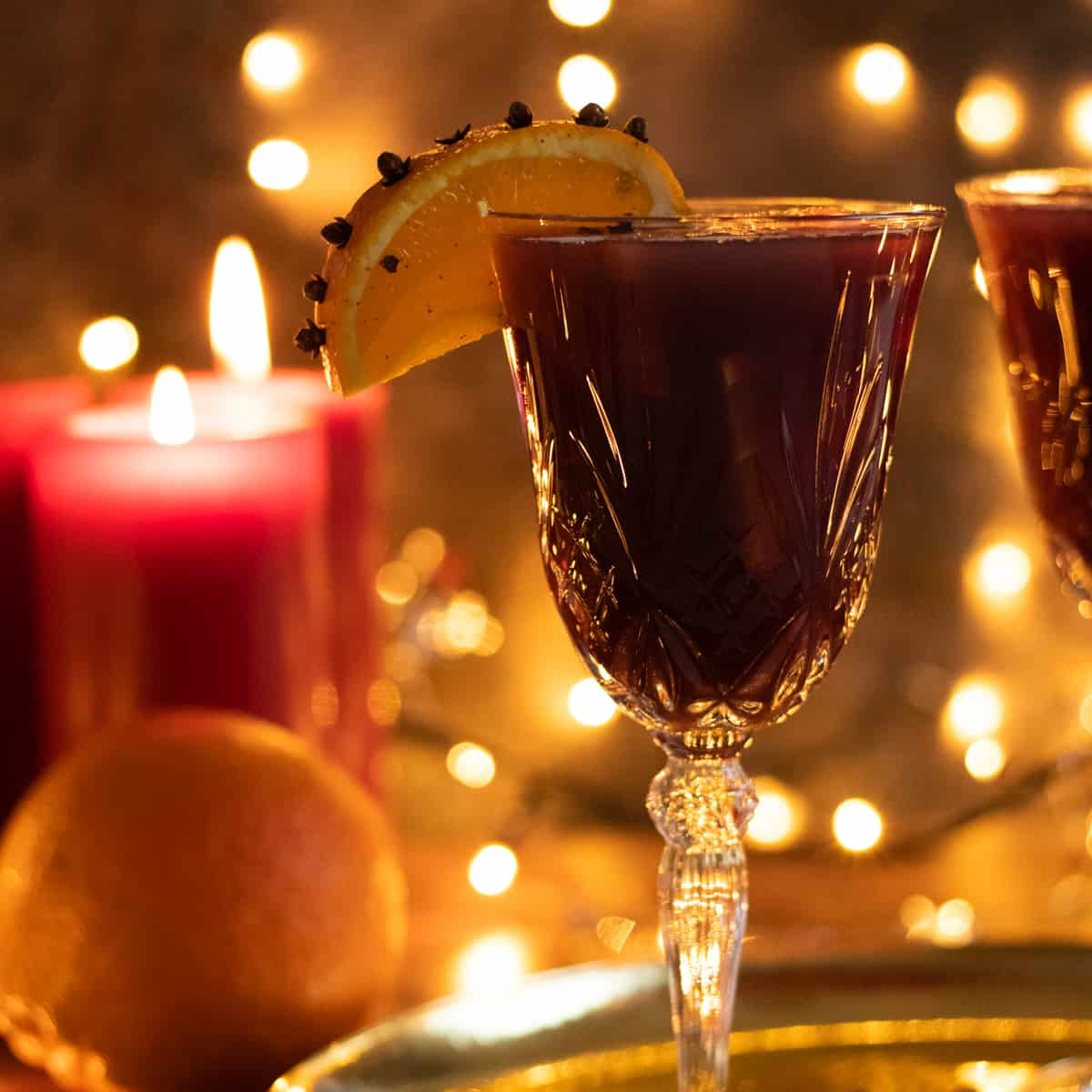 side view of a glass of christmas sangria