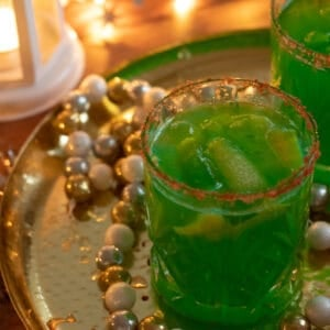 a glass of grinch punch