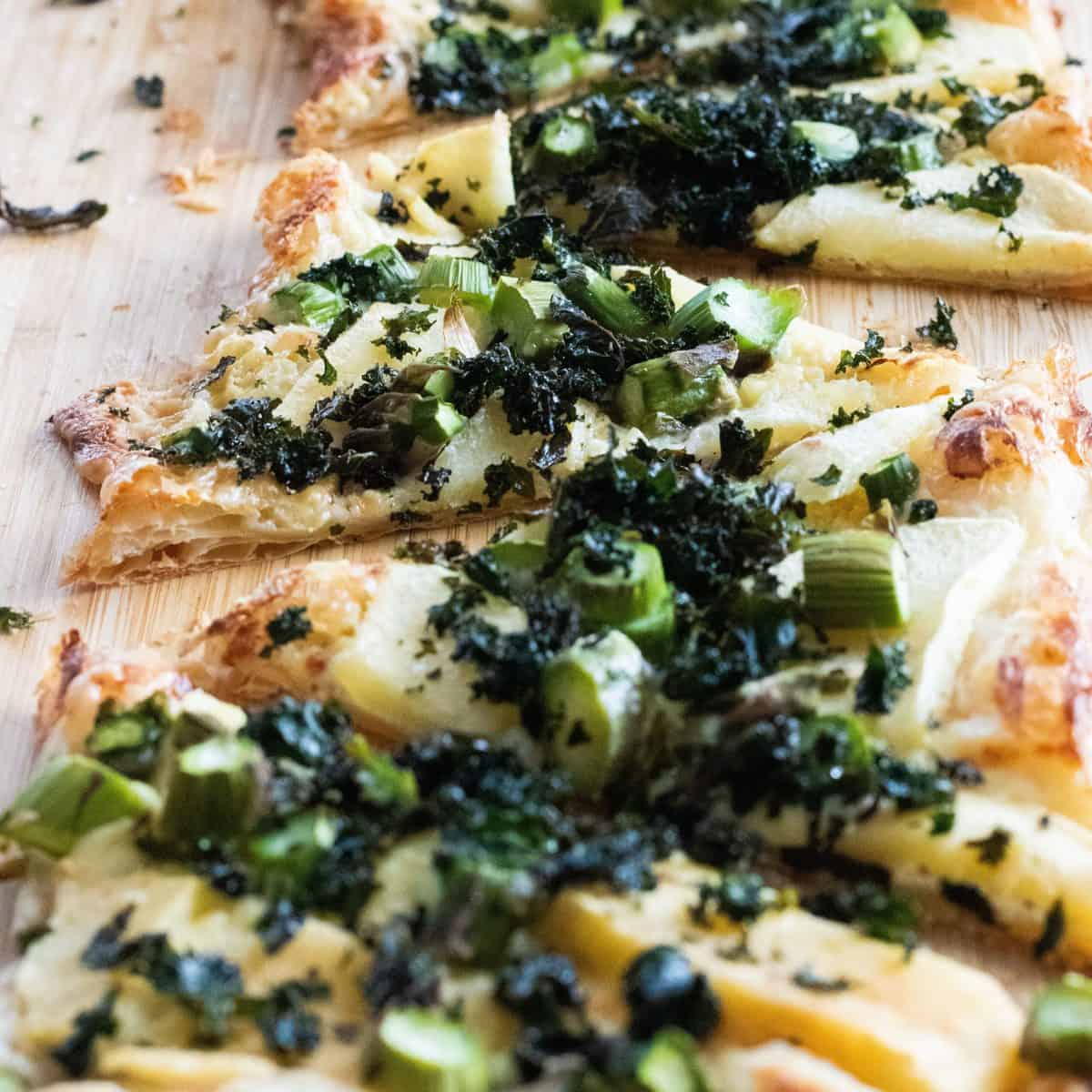 sliced puff pastry pizza with blue cheese and apples