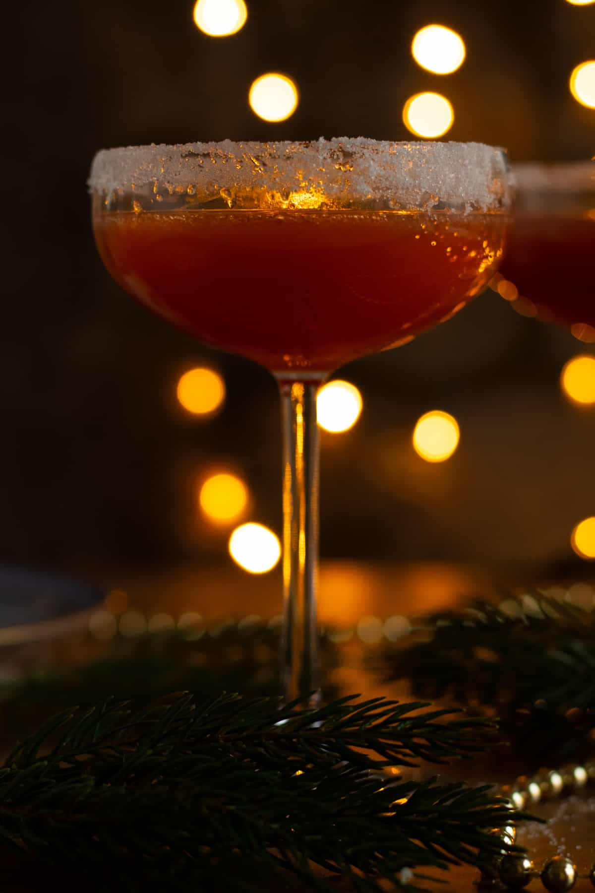 close up side view of a glass of sober santa christmas punch