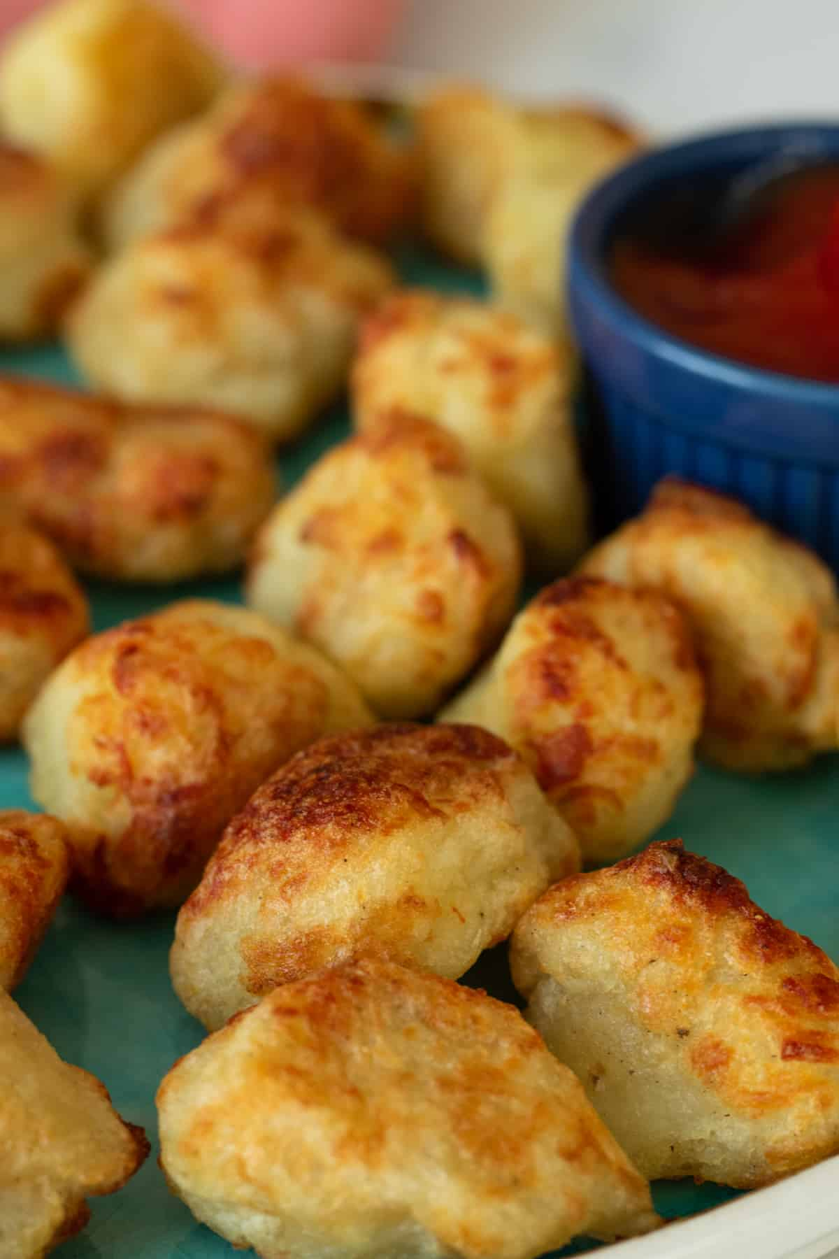 air fryer tater tots next to a small bowl with ketchup