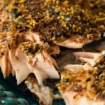 close up of furikake salmon on a blue green plate